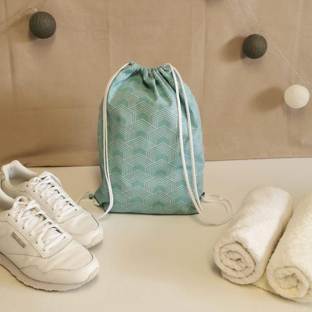 sac à chaussures vert d'eau à motifs géométriques blancs